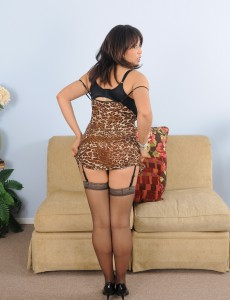 Big Breasted Lala Bond Shows off Her Garder and Pantyhose in the Livingroom