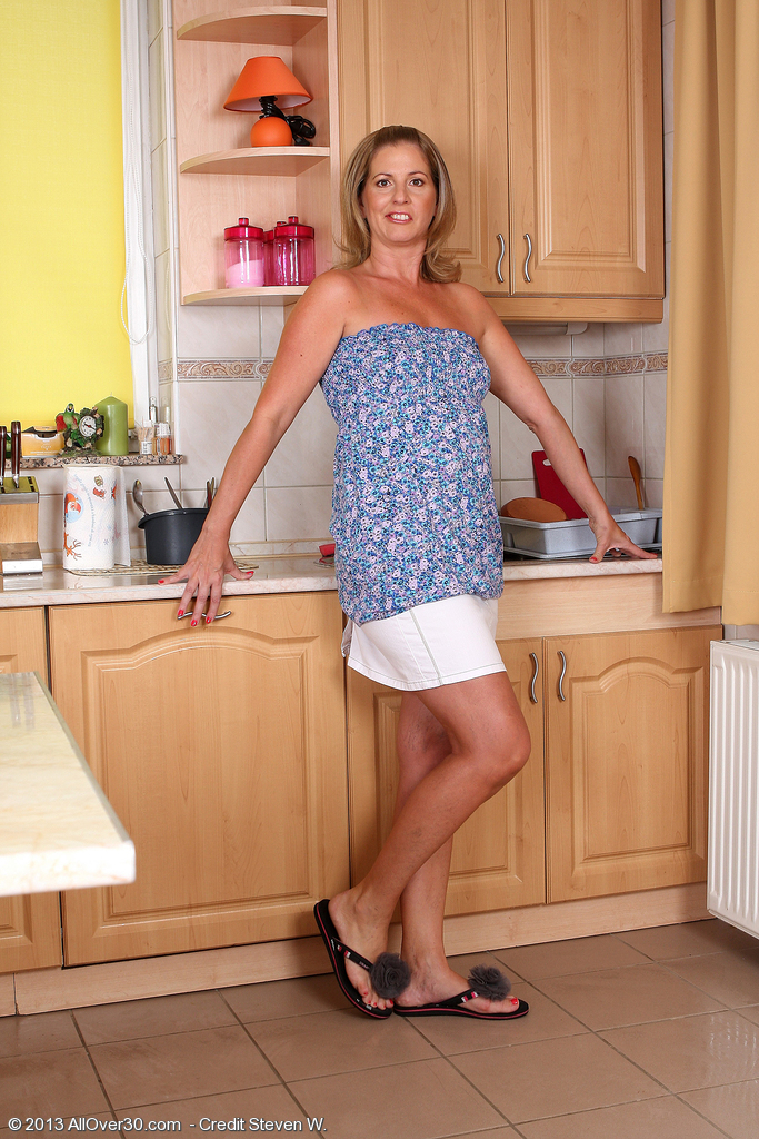 40 Year Old Laura G Works Up a  Bare Lather While Fooling in the Kitchen