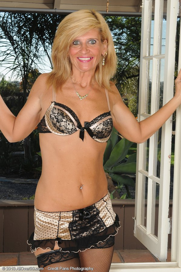 Wicked  Blond Haired Mature Lady in  Hot Dark Tights Flaunts Her Assets