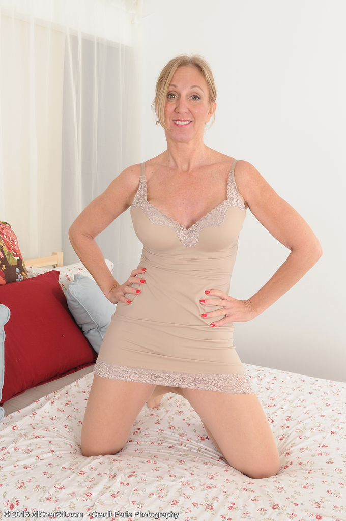 Fifty Year Old Golden-haired Playgirl Jenna Covelli Muscled out in Her Stockings