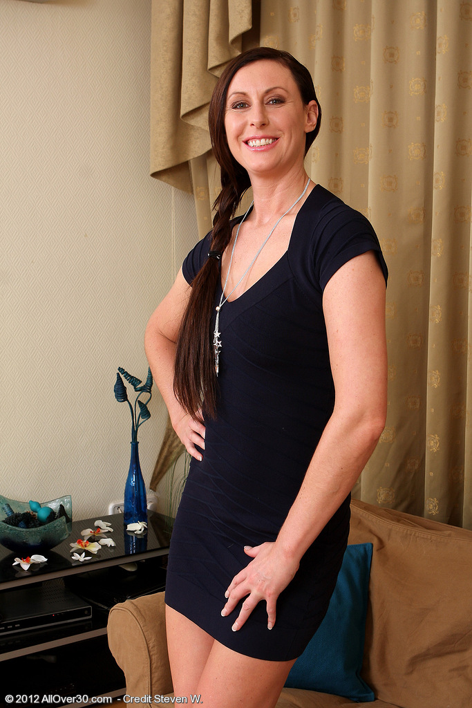 37 Year Old  Brown Haired Lara Latex Slips out of Her Elegant Dress Here