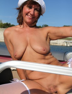 Nude very mature boat ride