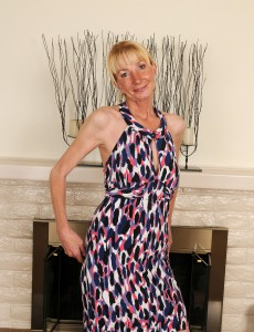 Elegant and Blond 57 Year Old Pam Strutting Around the Room Bare