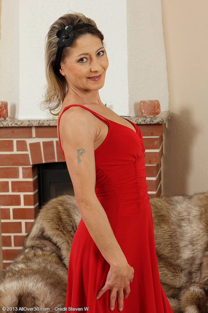 Elegant and Puny Syndi Bell from  Onlyover30 Posing in Her Hot Dress