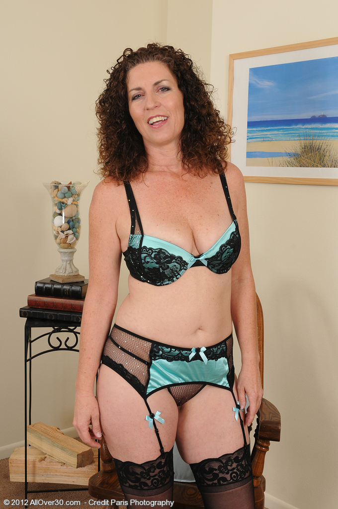 Sexy Older Tammy Sue from  Onlyover30 Sits in a Chair and Opens Up