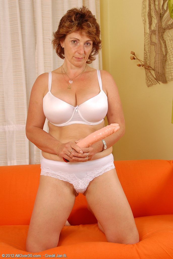 Older Misti Slides Her Large Dildo Deep Inside Her 42 Year Old Slit