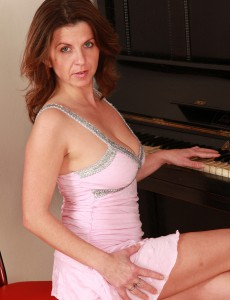36 Year Old Patris Demonstrating off Her Large  Older Pussy While on the Piano