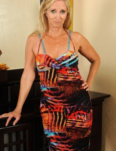 55 Year Old Annabelle Posing in Her Red Hot Belts and Pantyhose