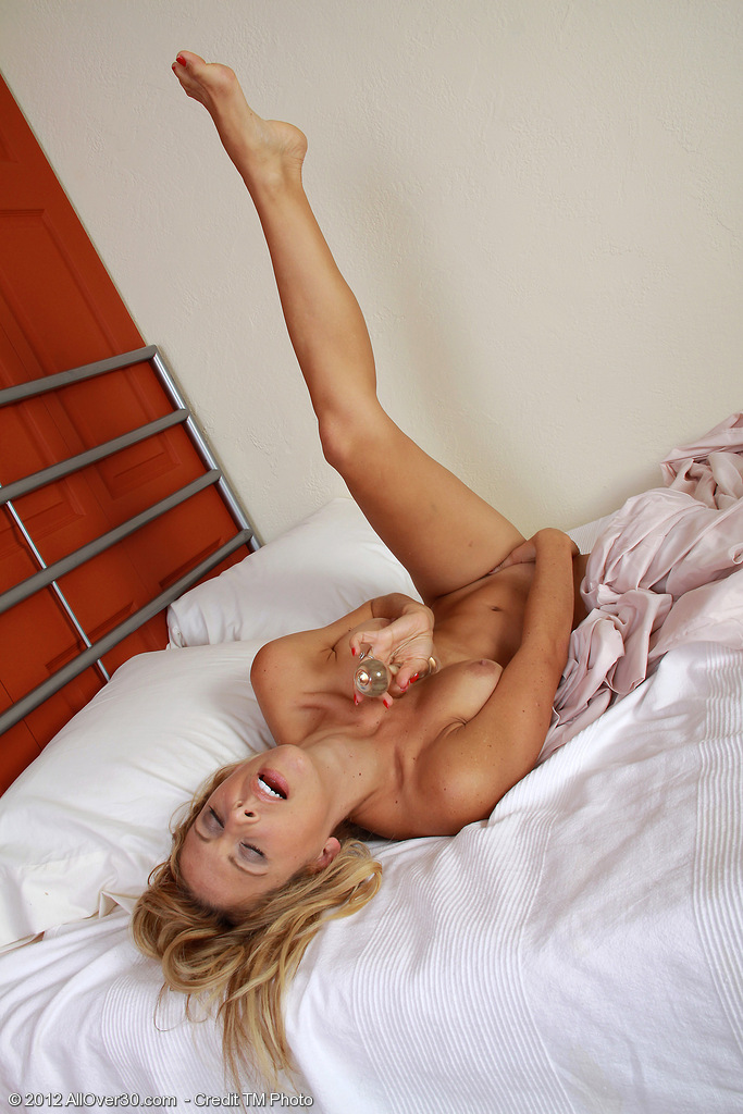 32 Year Old Milf Cherie Deville Glides a Glass  Dildo Deep Inside of Her