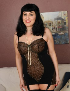 New Aged Model Claudine Dips a Strand of Pearls into Her Aged Box
