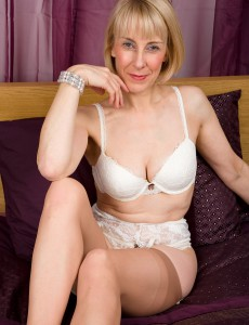 63 Year Old Hazel Pulls Her  Undies Aside to Display a Full Pubic Hair