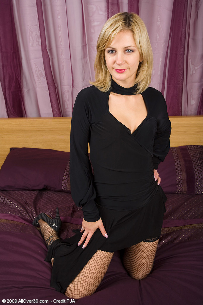 Hot  Blond Haired Milf Laurita Displaying off Her Black Pantyhose in Here