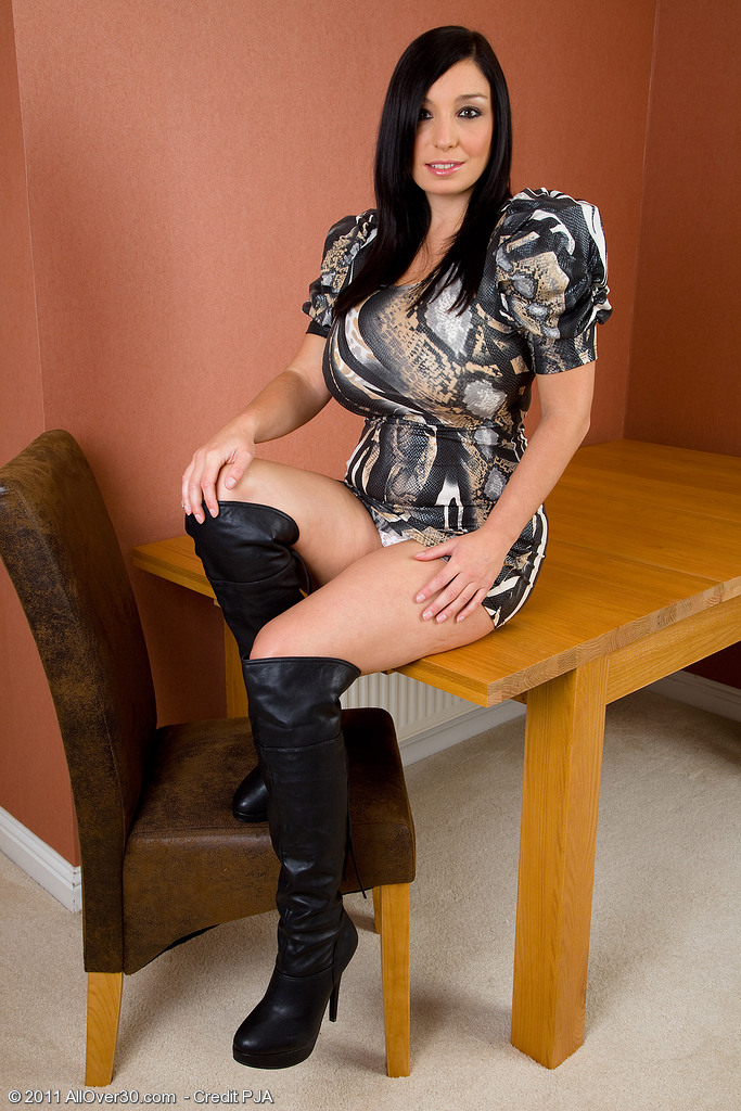 Darksome Haired and Very Huge-titted Michelle B Posing Elegantly on a Table