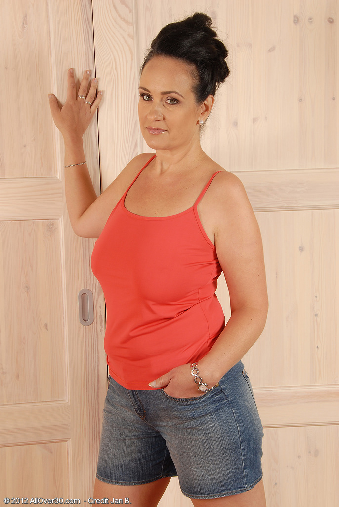 Big Breasted Milf Ria Dark Glides off Her Jeans and Speads Her Fuckbox