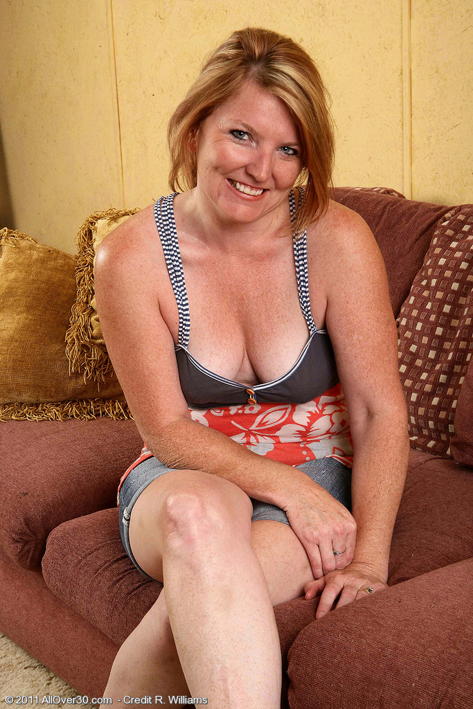 Nice 42 Year Old  Blond Haired Stacie Completely Enjoy Her Vibrator on the Sofa