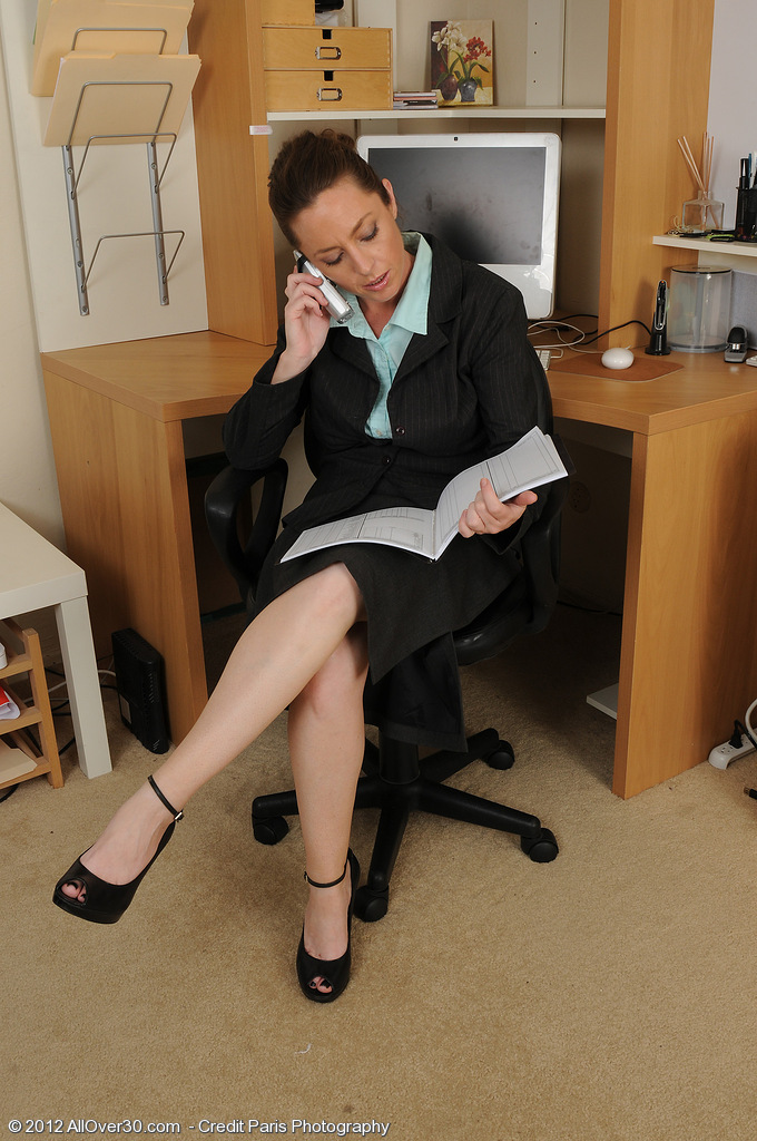 Office Angel Tamara Fox Puts Down the Telephone to Tug on Her Pussy