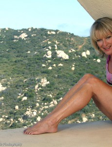 Popular Golden-haired Milf Tina from  Onlyover30 Poses at the Top of the World