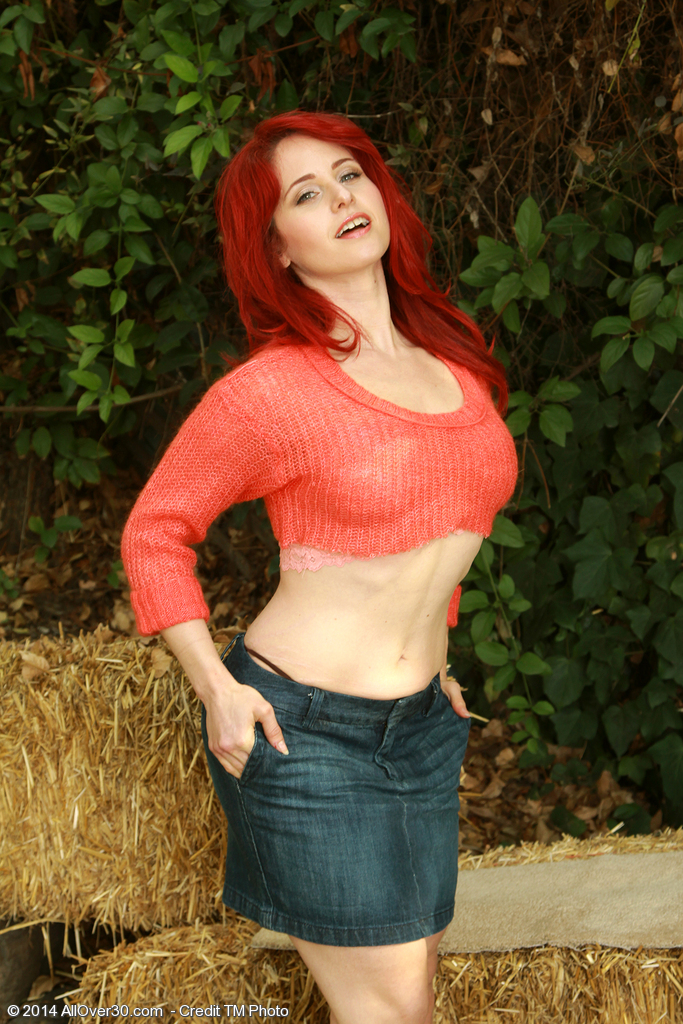 Sexually Excited 33 Year Old Redhead Andrea Rosu Posing  Nude About a Hay Bail