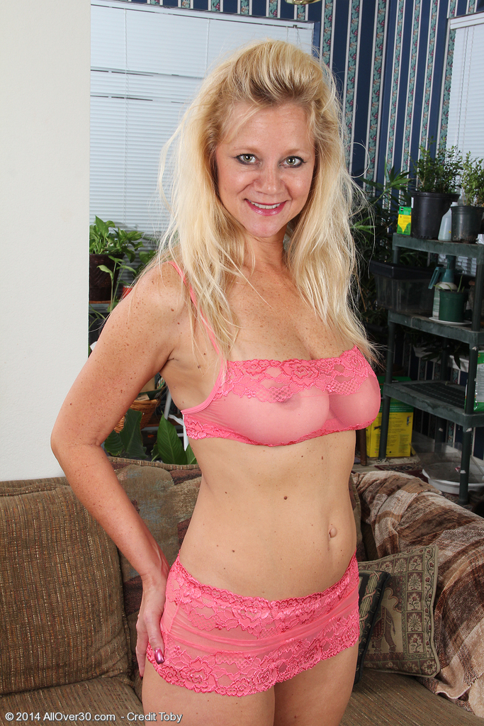 Big Breasted Golden-haired Milf Heidi Gallo Toying Her  Older Pussy Found on the Ottoman