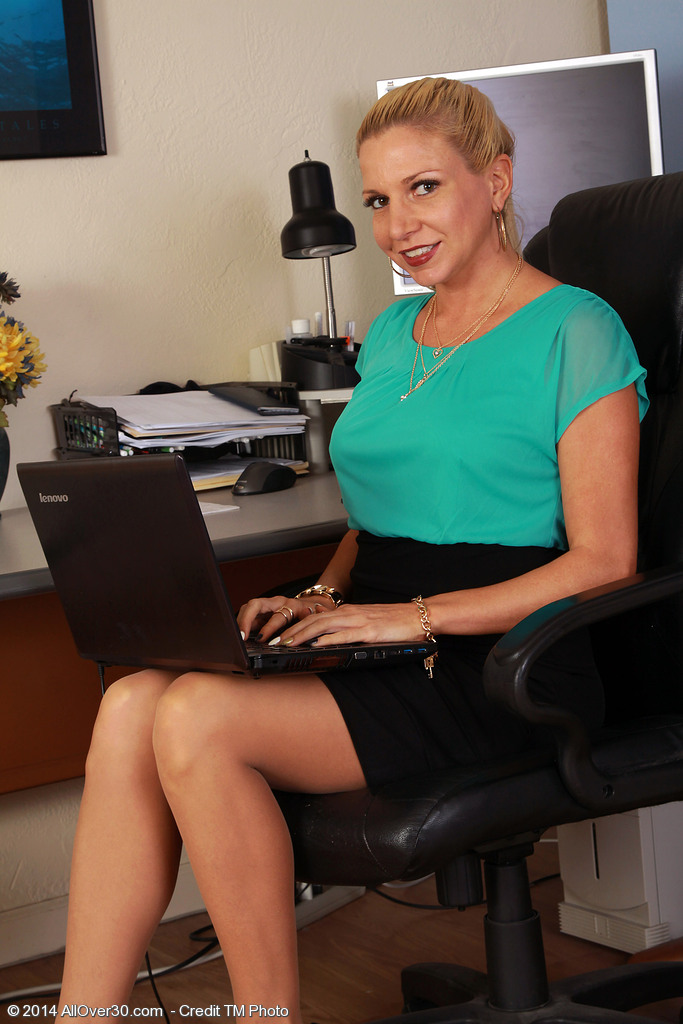 31 Year Old Jessica Taylor Undresses from Her Stockings at Her Office Desk