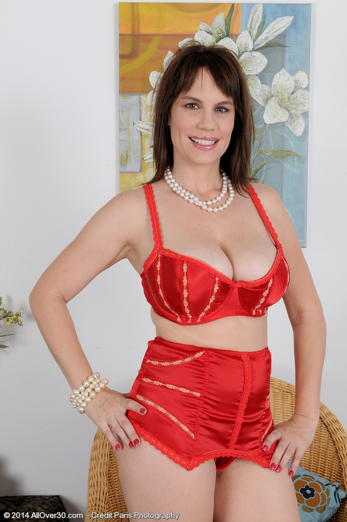 Hot and Breasty Kelly Capone  Glides out of Her Red Lace to Pose Here