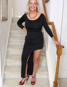 Beautiful 58 Year Old Judy Mayflower Playing with Her Bra-stuffers on the Stairs