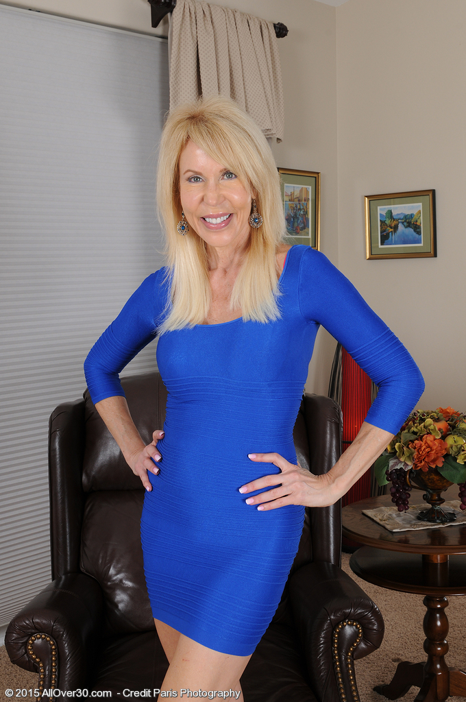 Elegant 60 Year Old Erica Lauren Slip out of Her Smooth Blue Suit