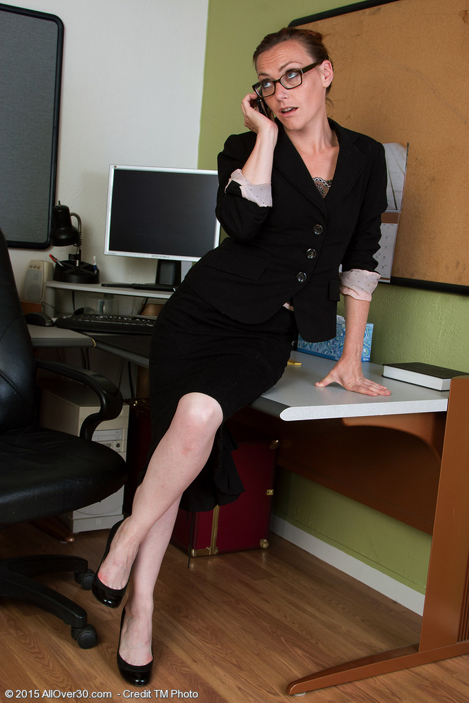 33 Year Old Amber K Disrobes and Plays with Her  Hoo Ha on Her Office Desk