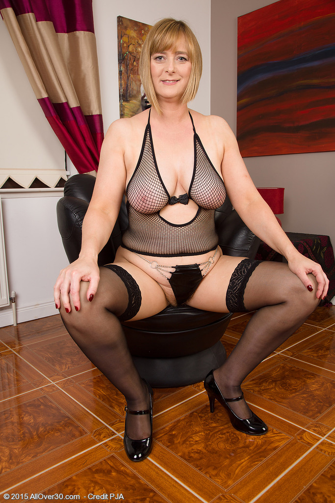 Breasty April Wraps Her Luxurious Milf Forms in Fishnet