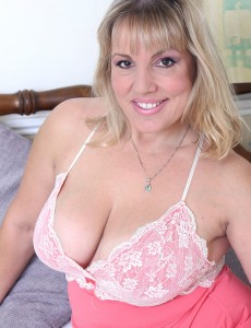 Curvaceous Danielle T Lounges on the Bed Gliding out of Her Nightie Looking Gorgeous