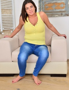 Curvaceous Hot Rye Eases on the Chair with Her Hand in Her Pants