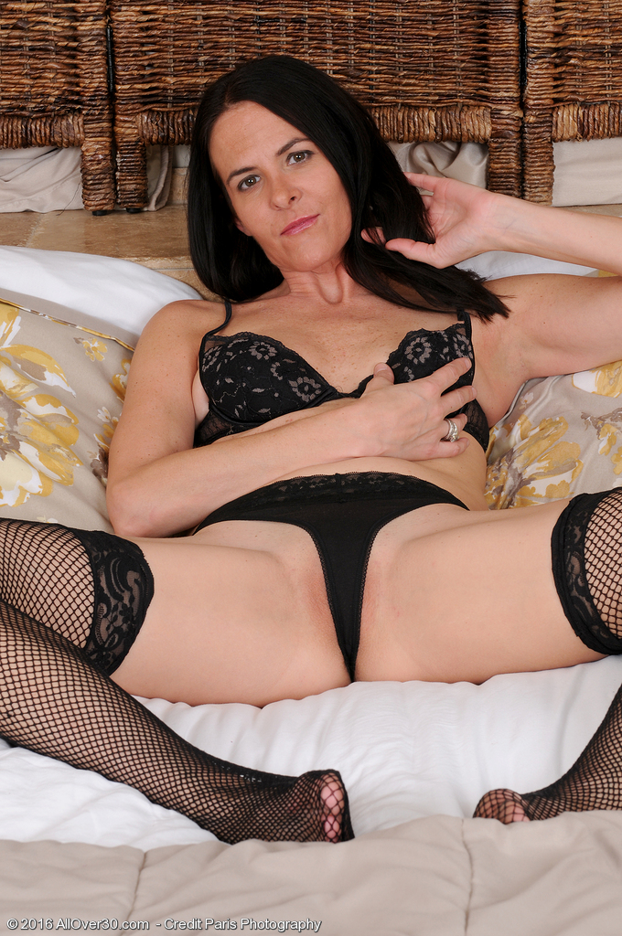 Passionate Maggie K Shows Those Long Fantastic Gams in Her Black Fishnet Tights