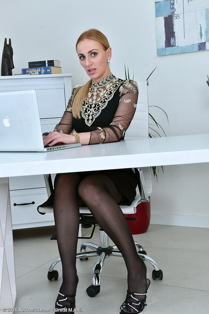 Leggy Golden-haired Afina Kisser Shows Her Secretary Style