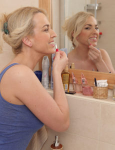 Blond Eve Valentine Admires Herself in the Mirror