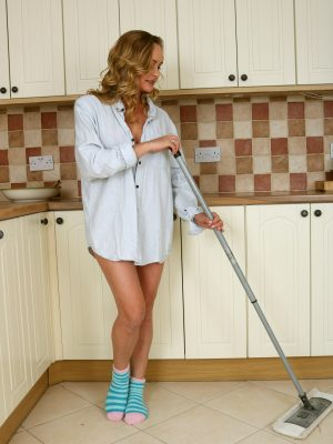 Elegant Eve mopping your kitchen