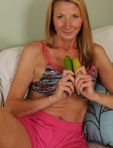 56 Year Old  Wifey Pam Tucks a Banana into Her Finely Mature Pussy