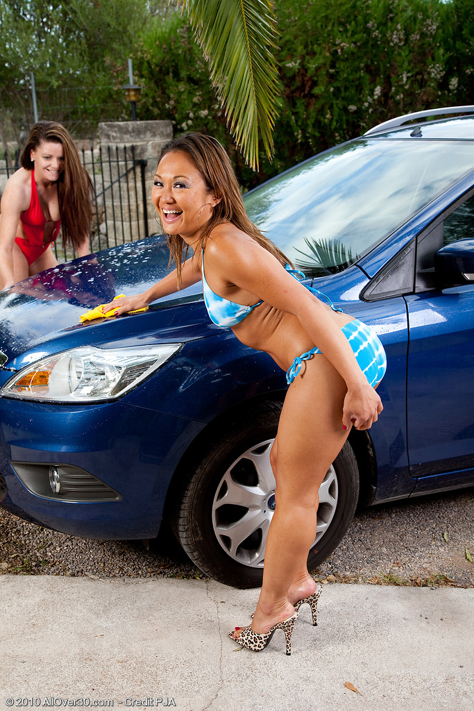 A Couple of Hot Milf Taking a Crack from Washing the Car