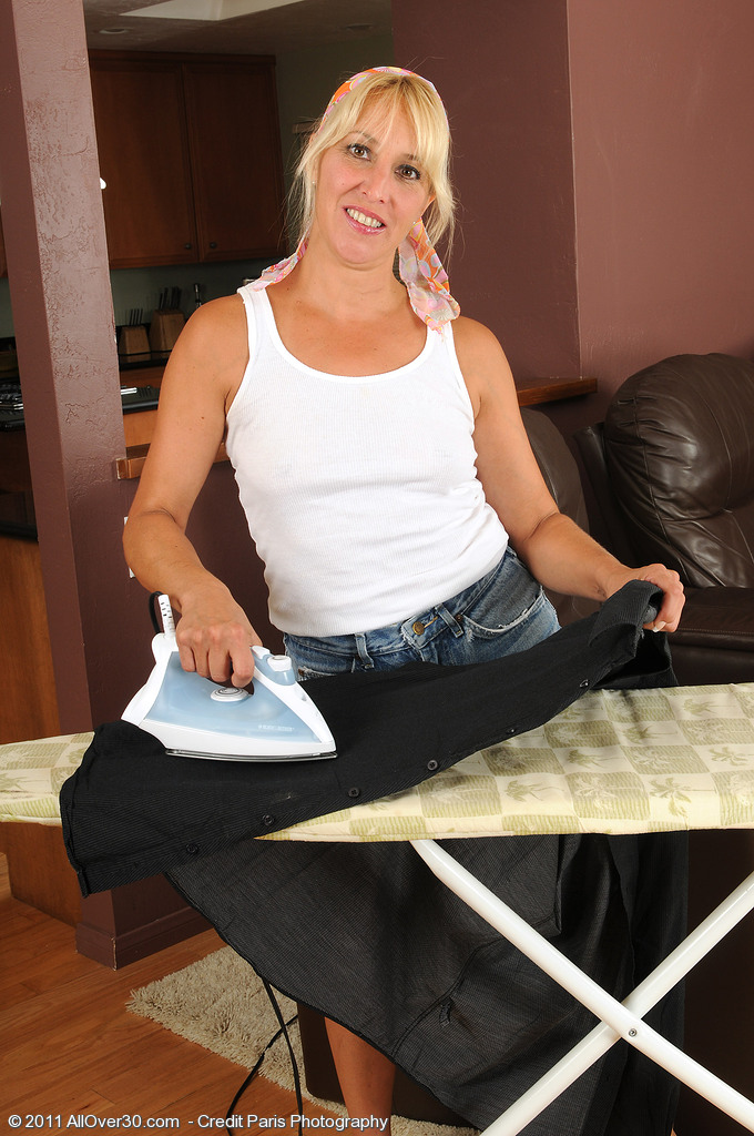 Blond  Wifey Andi Stops Ironing and  Undresses off Her Jeans Cut-offs