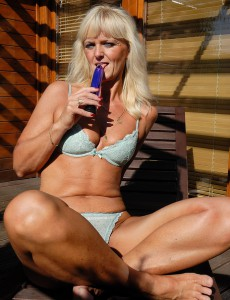43 Year Old  Blond Haired Jenny F Slides Her Long Purple Dildo Deep Inside