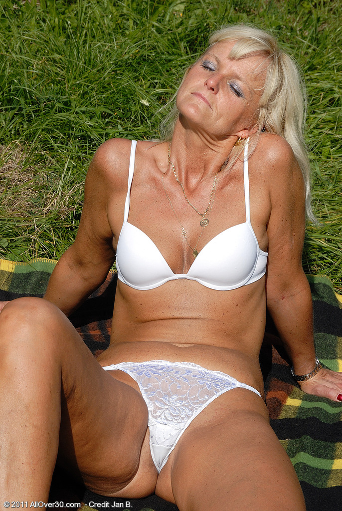 43 Year Old Jenny F  Undresses and Shows off Her Tight Ass in the Grass