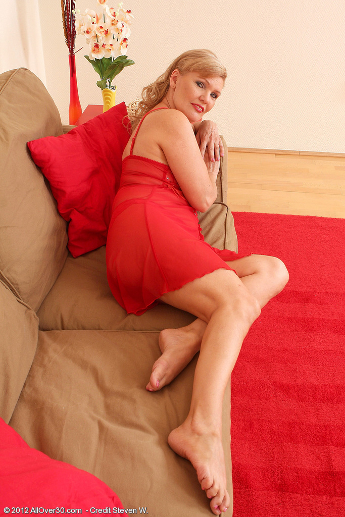 57 Year Old Lena F in  Hot Red Underware  Opens Her Gams on the Ottoman