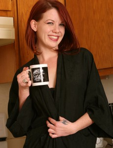 31 Year Old and Redheaded Lilla Katt Fooling Around Exposed in the Kitchen