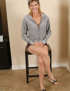 Older  Blond Haired Shows off Her Very Fur Covered Pussy in This Series of Fotos