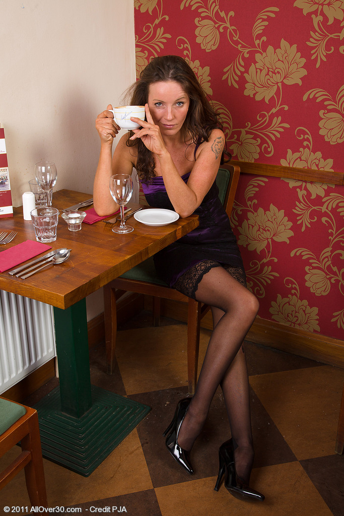 Sexy 41 Year Old and Elegant Marlyn Loving a Spoon with Her Coffee