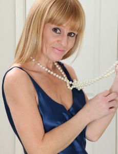 Slender Milf Penelope Slips off Her Elegant Blue Dress Just for You