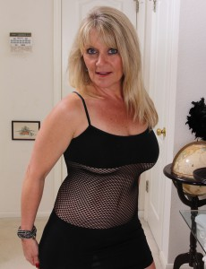 Nasty Blond 48 Year Old Sherri Donovan in Fishnet Underware Posing