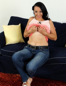 Breasty 37 Year Old Leona Yummy Lets Liberate Her Gigantic  Breasts Inwards Here