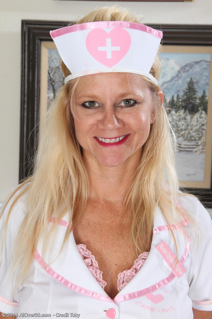 44 Year Old Heidi Gallo Dressed As a Nurse Opening Her Long Gams