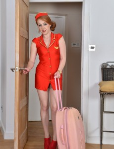 Killer Redhead Stewardess Tia Jones Gets Home and Flashes Her Unshaved Hole