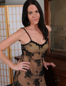 Elegant Milf Maggie K Eases in Her Boudoir in Her Sheet Slip, Flashing and Playing